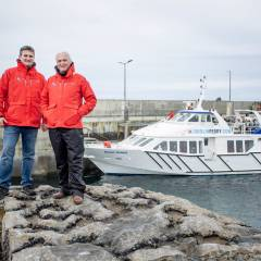 Liam O'Brien and Bill O'Brien at Doolin Pier launching the new Aran Islands Ferry