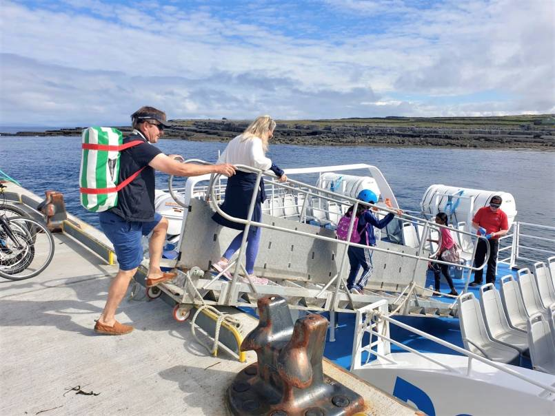 Passengers boarding Aran Islands Express ferry at Doolin Pier with Doolin Ferry Company.