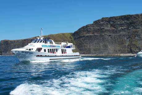 Doolin Ferry fleet sailing below the Cliffs of Moher on a cruise